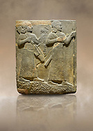 Photo of Hittite relief sculpted orthostat stone panel of Royal Buttress. Basalt, Karkamıs, (Kargamıs), Carchemish (Karkemish), 900-700 B C. Warriors. Anatolian Civilisations Museum, Ankara, Turkey.<br /> <br /> Two figures are seen, each with a long dress, a thick belt and curled hair. The figure in front carries a spear in his left hand and a long sword at his waist, and the figure behind carries an axe in his left hand and a quiver on his back.   <br /> <br /> Against a brown art background. .<br />  <br /> If you prefer to buy from our ALAMY STOCK LIBRARY page at https://www.alamy.com/portfolio/paul-williams-funkystock/hittite-art-antiquities.html  - Type  Karkamıs in LOWER SEARCH WITHIN GALLERY box. Refine search by adding background colour, place, museum etc.<br /> <br /> Visit our HITTITE PHOTO COLLECTIONS for more photos to download or buy as wall art prints https://funkystock.photoshelter.com/gallery-collection/The-Hittites-Art-Artefacts-Antiquities-Historic-Sites-Pictures-Images-of/C0000NUBSMhSc3Oo
