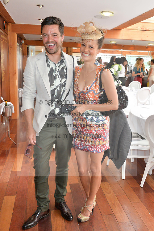 DOMINIC COOPER and THANDIE NEWTON at the Audi International Polo at Guards Polo Club, Windsor Great Park, Egham, Surrey on 26th July 2014.