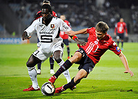 FOOTBALL - FRENCH CHAMPIONSHIP 2009/2010  - L1 - LILLE OSC v Rennes - 17/10/2009 - <br /> <br />  ISMAEL BANGOURA (REN) / ARNAUD SOUQUET (LIL)<br /> Norway only