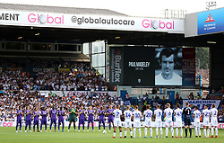 Fans and players hold a minutes applause in memory of former Leeds United player Paul Madeley prior to kick off during the Sky Bet Championship match at Elland Road, Leeds.