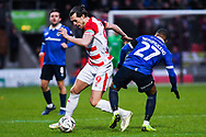 John Marquis of Doncaster Rovers (9) gets past Gevaro Nepomuceno of Oldham Athletic (27) during the The FA Cup fourth round match between Doncaster Rovers and Oldham Athletic at the Keepmoat Stadium, Doncaster, England on 26 January 2019.