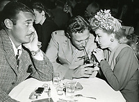 1944 Jon Hall watches Francis Langford sip a drink with a soldier at Ciro's Nightclub