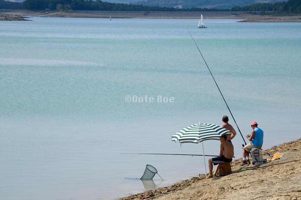 recreational fishing at a lake shore