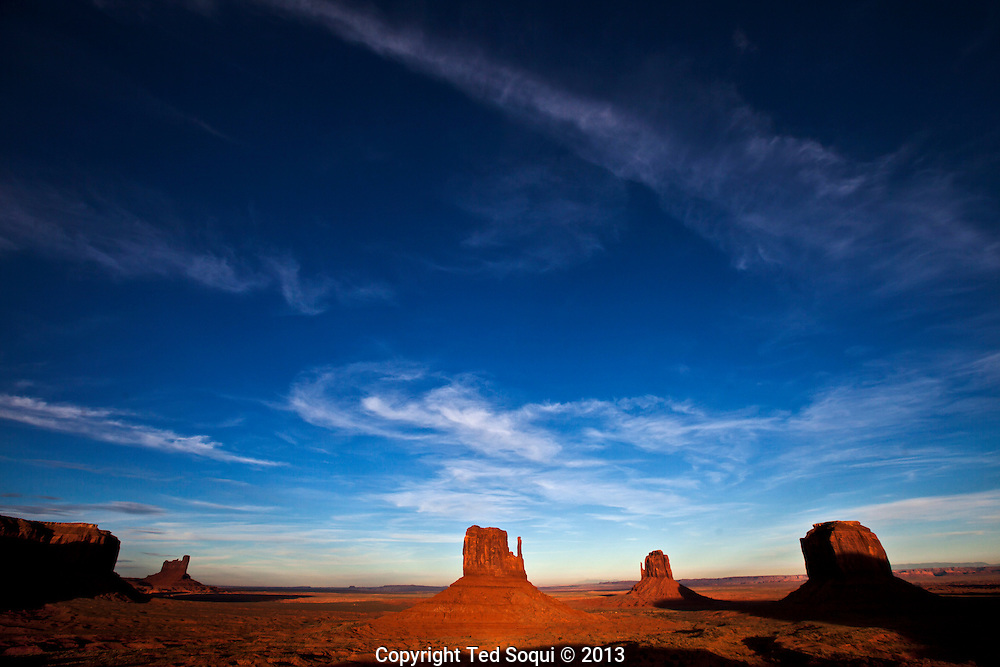 West and East Mitten buttes inside the Monument Valley Tribal Park at sunset. The parked is owned and operated by the Navajo people.