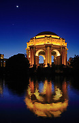 San Francisco Fine Arts Palace at night. The Palace of Fine Arts in the Marina District of San Francisco, California, is a monumental structure originally constructed for the 1915 Panama-Pacific Exposition in order to exhibit works of art presented there. One of only a few surviving structures from the Exposition, it is the only one still situated on its original site. It was rebuilt in 1965, and renovation of the lagoon, walkways, and a seismic retrofit were completed in early 2009.<br /> <br /> In addition to hosting art exhibitions, it remains a popular attraction for tourists and locals, and is a favorite location for weddings and wedding party photographs for couples throughout the San Francisco Bay Area, and such an icon that a miniature replica of it was built in Disney's California Adventure in Anaheim.