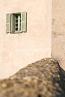 Window in wall of historic toll building in Sospel, France