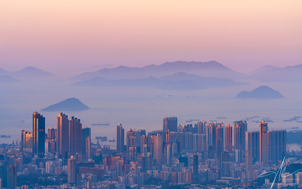 Morning sun started painting Hong Kong with orangish hue while a layer of sea mist can be seen blanketing the outlying islands.