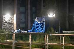 © Licensed to London News Pictures. 31/05/2021. London, UK. A forensic tent at the crime scene at Montrose Park, Edgware following the fatal stabbing of an 18-year-old male. Metropolitan Police were called at 17:54 BST on Monday 31/05/2021 following reports of a group of males fighting. The man was found suffering from a stab injury in a tennis court area. He was treated by London's Air Ambulance and London Ambulance Service at the scene but was pronounced dead at 19:19 BST. Photo credit: Peter Manning/LNP