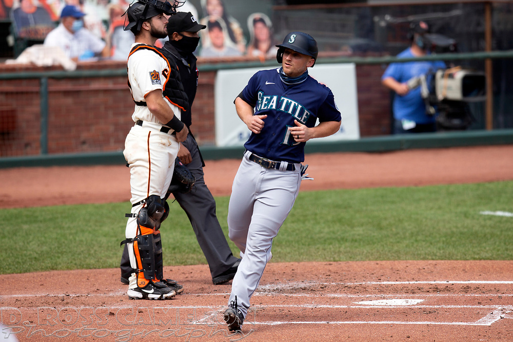 Seattle Mariners' Kyle Seager (15) scores on an RBI single by Tim Lopes during the second inning of a Major League Baseball game against the San Francisco Giants, Thursday, Sept. 17, 2020 in San Francisco. This is a makeup of a postponed game from Wednesday in Seattle. (AP Photo/D. Ross Cameron)