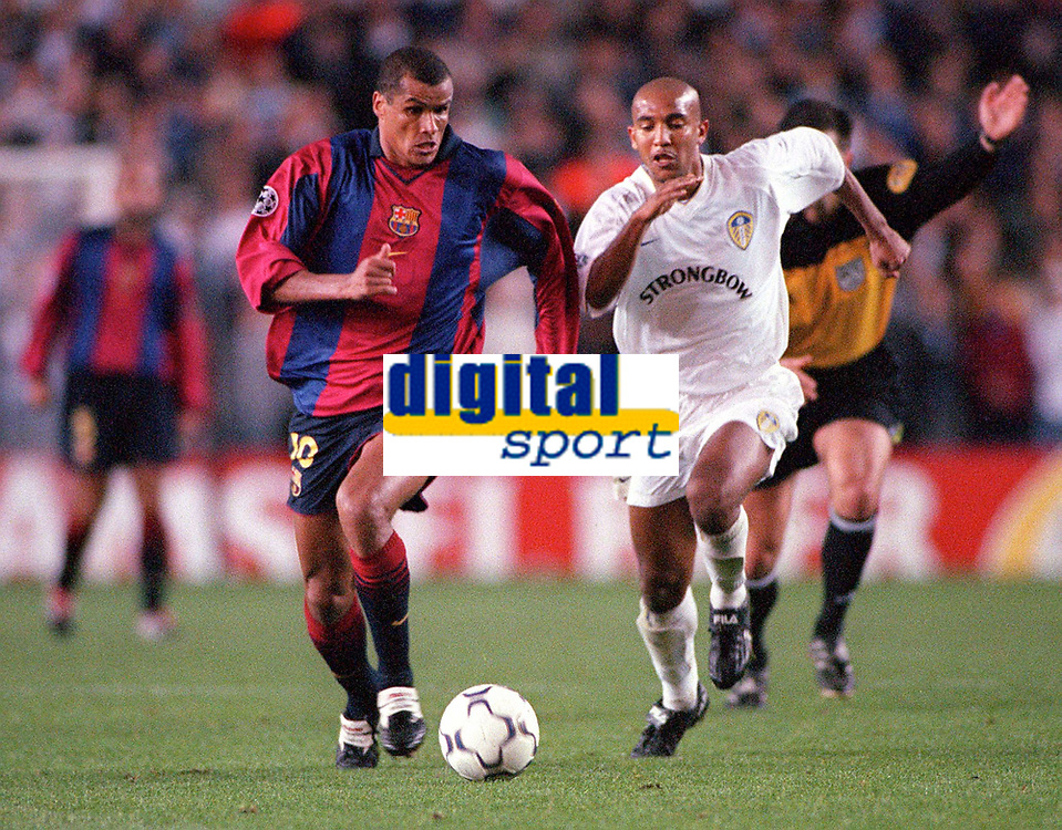 Rivaldo (Barcelona) with Olivier Dacourt (Leeds) in pursuit. Leeds United v Barcelona. European Champions League, Group H, 24/10/00. Credit: Colorsport / Andrew Cowie.