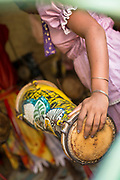 Close up of woman playing drum in traditional clothing, Havana, Cuba