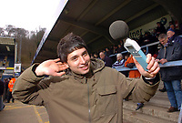 Photo: Leigh Quinnell.<br /> Wycombe Wanderers v Shrewsbury Town. Coca Cola League 2. 11/03/2006. Reporter Nic Brunelti tests the noise in the crowd.