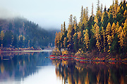 Fall colors reflect on Salmon Lake, Montana.