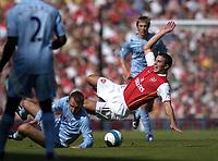 Photo: Olly Greenwood.<br />Arsenal v Manchester City. The FA Barclays Premiership. 25/08/2007. Ditmar Harmann fouls Robin Van Persie