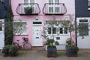 A beautiful pink terrace house near Portobello Road on the 26th March 2018 in Notting Hill, United Kingdom.