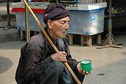 Myanmar and Thailand border at Mai Sai an old beggar