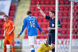 St Johnstone's Murray Davidson gets a yellow cardafter his challenge on Kilmarock's keeper Conor Brennan.<br /> St Johnstone 1 v 2 Kilmarock, SPL game played at McDrarmid Park.