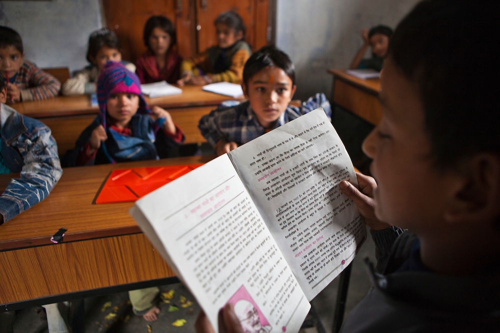 A young boy reading to his class in a lesson at the Alternate Learning Hub, Subhai, Himalayas, India. The school is organized and funded by the Pragya charity.  Pragya is a non-profit organization providing education and information services in high altitude areas in the Himalayas.