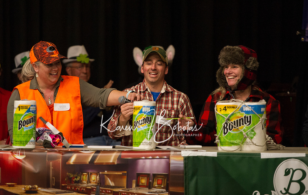 """The """"Bounty Hunters"""" from Gilford High School Jessica Bishop, Anthony Sperazzo and Louise Jagusch correctly spell sophomore to make it to the next round during the 19th annual Lakes Region Scholarship Foundation's Spelling Bee at LHS on Thursday evening.  (Karen Bobotas/for the Laconia Daily Sun)"""