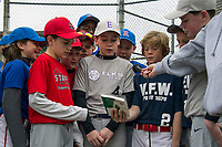 Major League players from Laconia Rotary, VFW, Stafford Oil and the Elks join together at home plate to recite the Little League Pledge prior to taking the field for opening day at Colby Field Saturday morning.  (Karen Bobotas/for the Laconia Daily Sun)