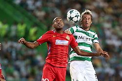 August 15, 2017 - Lisbon, Portugal - Steaua's midfielder William Amorim (L) heads the ball with Sporting's defender Fabio Coentrao from Portugal during the UEFA Champions League play-offs first leg football match between Sporting CP and FC Steaua Bucuresti at the Alvalade stadium in Lisbon, Portugal on August 15, 2017. (Credit Image: © Pedro Fiuza/NurPhoto via ZUMA Press)