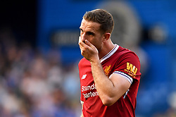 Liverpool's Jordan Henderson appears dejected at the end of the Premier League match at Stamford Bridge, London.