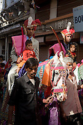 A wedding procession with grooms riding white horses as tradition dictates at Hindu wedding ceremonies.