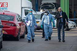 © Licensed to London News Pictures. 08/03/2021. London, UK. Forensic investigators look over a red car close to White Hart Lane after a man was found with fatal stab injuries on Penshurst Road, a second man, who is 18-years-old, was treated for stab wounds and taken to hospital. Photo credit: Peter Manning/LNP