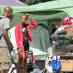 Naquila Chambers-Moore, r, and friend Chris Johnson talks as City of Austin  (TX) police supervise while city workers clean out a large homeless protest camp on the north side of City Hall mid-morning. Police arrested multiple homeless who refused to cooperate after several weeks of warnings and offers of assistance.