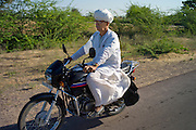 Indian man travelling on motorcycle at Rohet, Rajasthan, Northern India