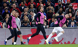 England's Jordan Henderson, Harry Kane and Wayne Rooney warm up on the sidelines