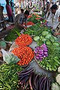 A vendor assists a customer at the Sonargaon market outside Dhaka, Bangladesh.