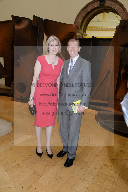The Home Secretary THERESA MAY and her husband PHILIP MAY at the preview party for The Royal Academy Of Arts Summer Exhibition 2013 at Royal Academy of Arts, London on 5th June 2013.