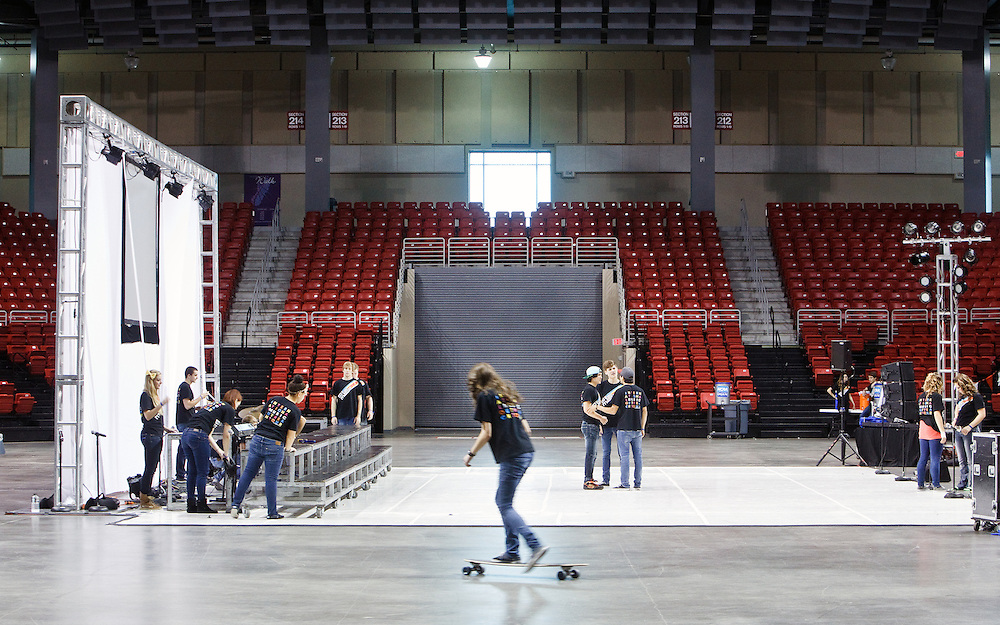 Performers from The Young Americans prepare the set for a music performance workshop Tuesday at the Heartland Events Center. The Young Americans is a group of trained performers ages 18-24 that travel around the world to dance and sing with students and provide learning opportunities.This years cast of cast of 46 members included five former Northwest High School Students. (Independent/Matt Dixon)