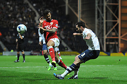 Greg Cunningham of Preston North End clears the ball under pressure from Marlon Pack of Bristol City - Mandatory byline: Dougie Allward/JMP - 07966386802 - 15/09/2015 - FOOTBALL - Deepdale Stadium -Preston,England - Bristol City v Preston North End - Sky Bet Championship