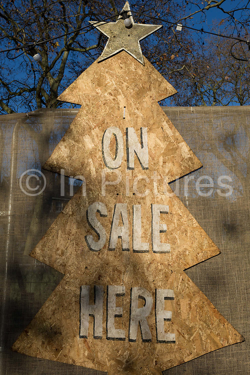 An detail of a Christmas Tree sign of a business pun called Tree Amigos on Goose Green in East Dulwich, in south London, England, on 4th December 2019.