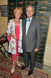 NEIL & CHRISTINE HAMILTON at The House of Britannia reception hosted by Lady Delves Broughton at 42 Berkeley Square, London on 26th June 2014.