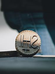 THEMENBILD - ein IHS-Brotstempel aus Metall liegt auf einem Holzbrett, aufgenommen am 10. April 2020 in Kaprun, Oesterreich // an IHS metal bread stamp lies on a wooden board, in Kaprun, Austria on 2020/04/10. EXPA Pictures © 2020, PhotoCredit: EXPA/Stefanie Oberhauser