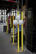Three balloons obscure the head of a man smoking outside an office on Fleet Street, on 17th October 2017, in the City of London, England.