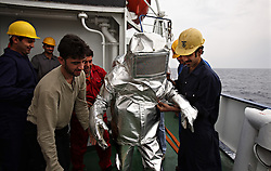 The crew of the Bisanzio practice weekly rescue and fire drills on board the ship while traveling between Egypt and Lebanon in the Mediterranean Sea on April 10, 2008. Here, Bosun Sami Tartoussi, of Lebanon, wears the fire suit. The Bisanzio, a feeder ship taking containers from Port Said to Beirut, is Lebanese owned, has three different nationalities aboard, and flies a St. Vincent flag.