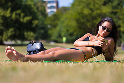 Chef  Yumiko Scintu, 29, from Camden enjoys the hot sunshine on Primrose hill in North London. London, August 06 2018.