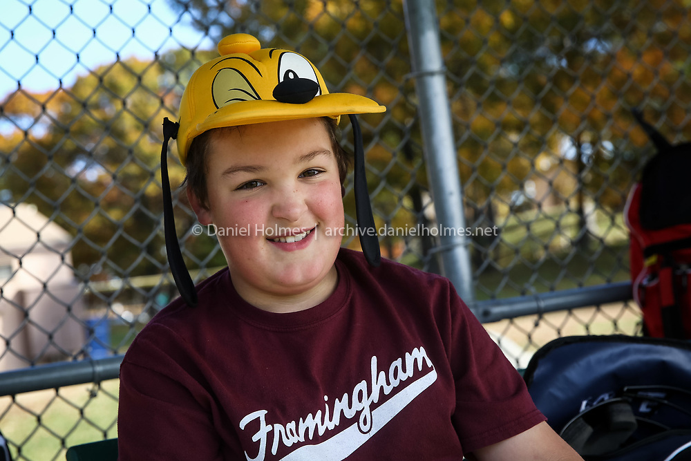 (10/31/15, FRAMINGHAM, MA) Calvin Poole, 11, of Framingham, sports a Goofy hat during the Framingham Baseball League's 2015 Halloween Games at the Little League Complex in Framingham on Saturday. Daily News and Wicked Local Photo/Dan Holmes