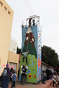 Child climbs a portable climbing wall