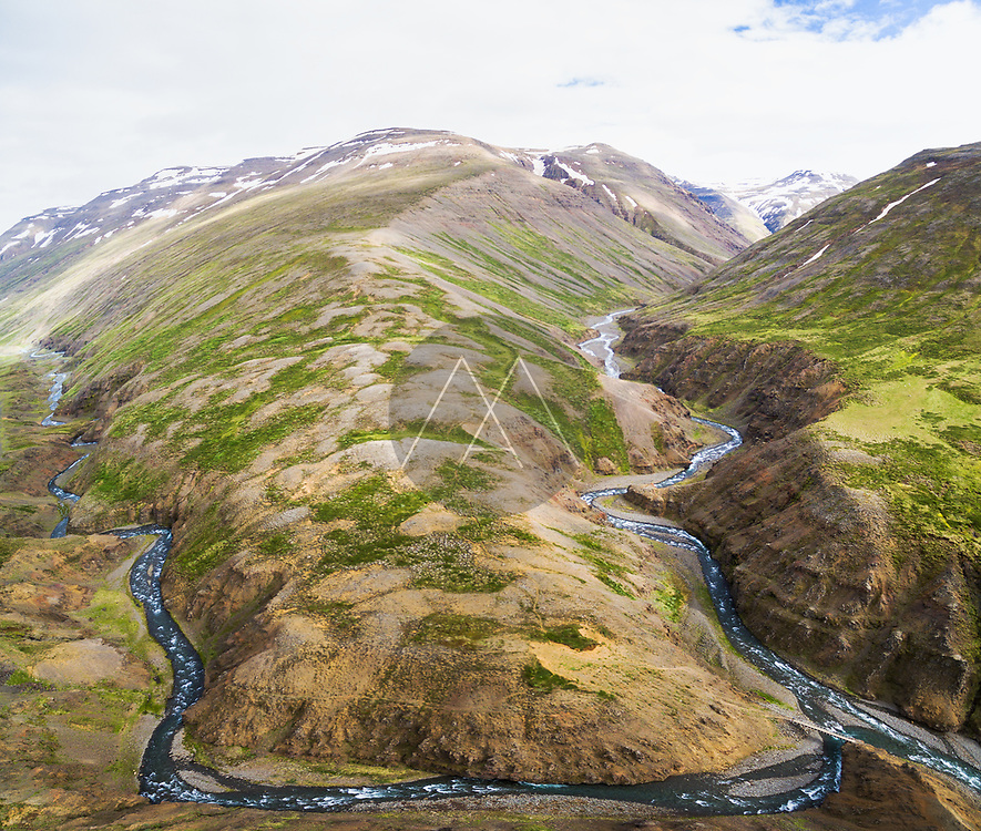 Aerial view of streams between snow-covered mountains, Oxnadalsheidi, northern Iceland