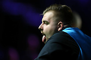 Jackson Page, the 16 year old from South Wales reacts during his 1st round match against Sean O'Sullivan. ManBetx Welsh Open Snooker 2018, day 1 at the Motorpoint Arena in Cardiff, South Wales on Monday 26th February 2018.<br /> pic by Andrew Orchard, Andrew Orchard sports photography.