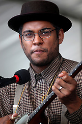 28 April 2012. New Orleans, Louisiana,  USA. .New Orleans Jazz and Heritage Festival. .Dam Flemons of the Grammy award winning traditional folk band the Carolina Chocolate Drops..Photo; Charlie Varley.