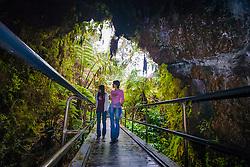 woman tourists, hiking rainforest trail, Nahuku - Thurston Lava Tube, Hawaii Volcanoes National Park, Kilauea, Big Island, Hawaii, USA, MR