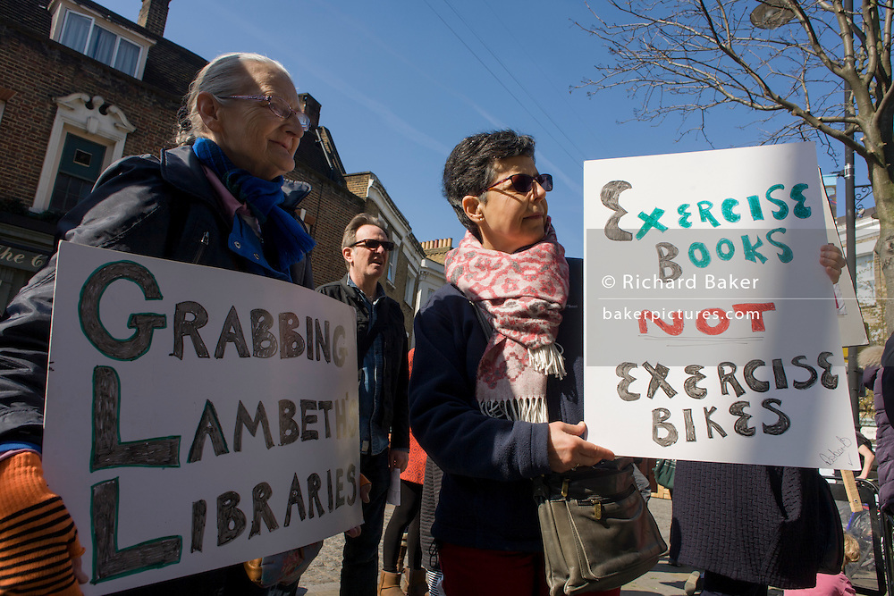 Police talk to local campaigners protesting the closure by Lambeth council of Carnegie Library, in Herne Hill, south London on 2nd April 2016. The angry local community in the south London borough have occupied their important resource for learning and social hub for the weekend. After a long campaign by locals, Lambeth have gone ahead and closed the library's doors for the last time because they say, cuts to their budget mean millions must be saved. A gym will replace the working library and while some of the 20,000 books on shelves will remain, no librarians will be present to administer it. London borough's budget cuts mean four of its 10 libraries will either close, move or be run by volunteers.