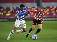 Football - 2020 / 2021 Sky Bet Championship - Brentford vs Reading - Brentford Community Stadium<br /> <br /> Reading's Josh Laurent battles with Brentford's Sergi Canos.<br /> <br /> COLORSPORT/ASHLEY WESTERN