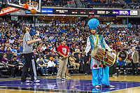 Sacramento, California | 2014<br /> Sukhdeep Singh, a member of bhangra troupe Ankhiley Gabroo, performs during halftime for Sikh Appreciation Night at the Sacramento Kings basketball game. Greater Sacramento is home to a large Sikh community that traces its roots to laborers who worked on farms in the Central Valley in the 1920s.